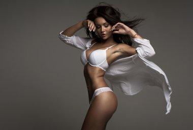 Brunette beauty wearing white floating shirt