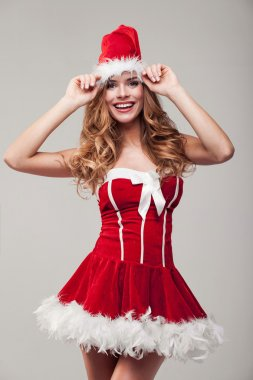 Happy woman wearing santa clause costume