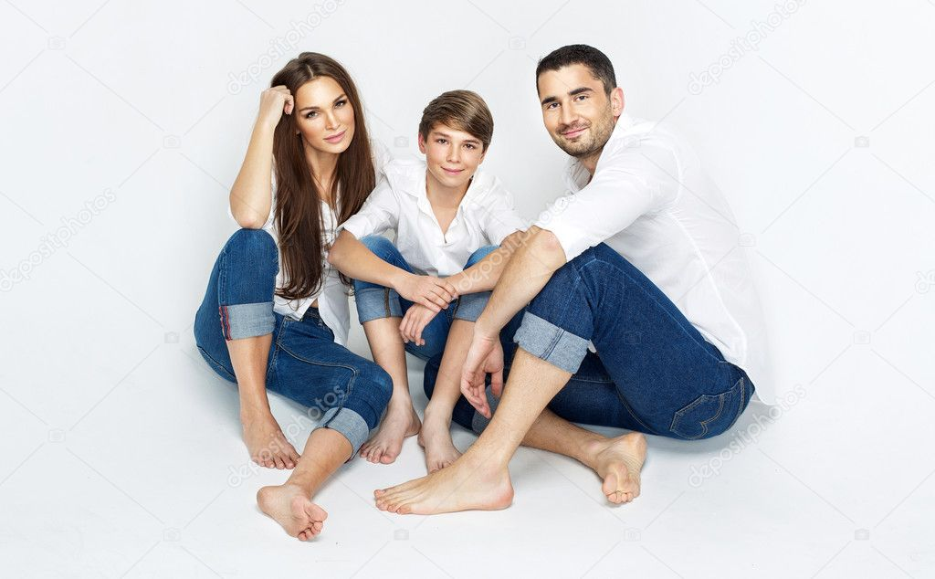 Young family wearing jeans and white shirt stock photo