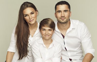 Portrait of a young happy familly in white shirts