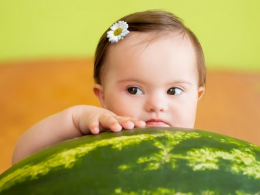 Pretty baby girl with big watermelon