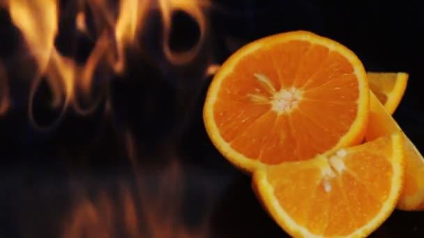 Orange fruit in fire flame