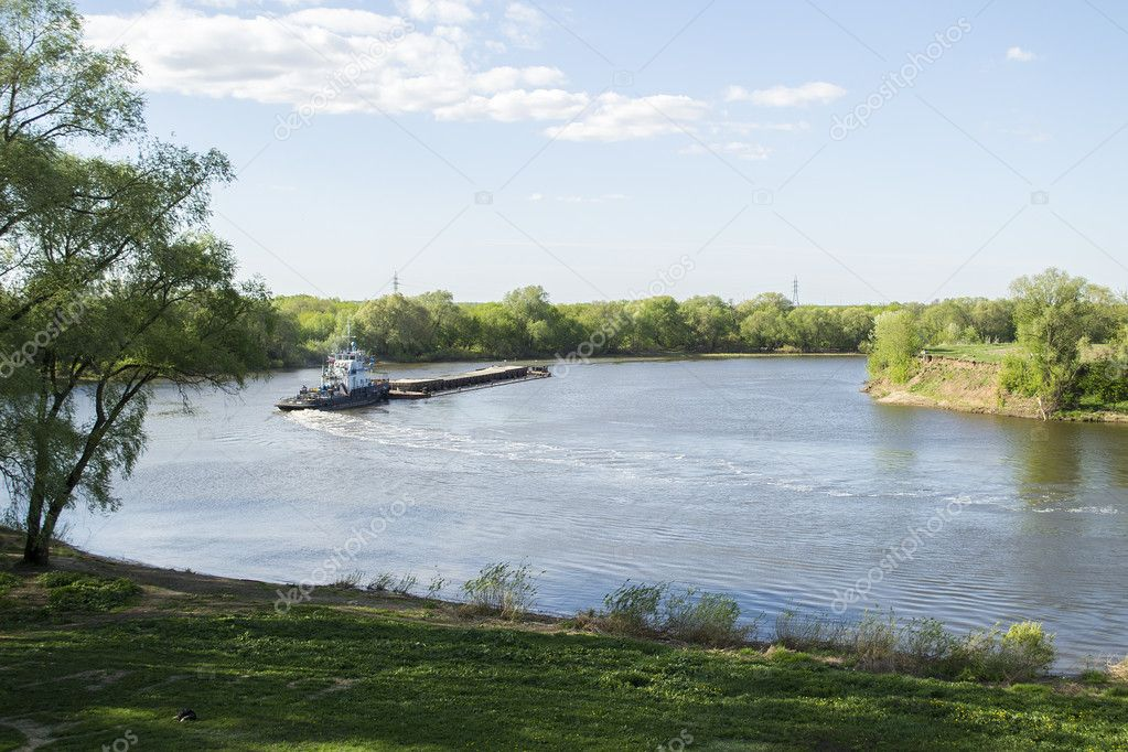 Towboat and Barge on the River in the Russian Country