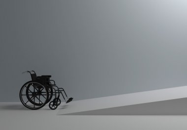 wheelchair in front of the ramp for the disabled