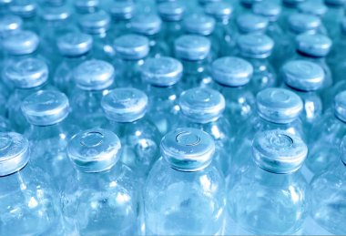 bottles of medicine in a row.