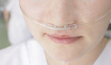 Breathing through a plastic nasal catheter during illness