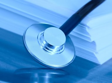 stethoscope and a stack of paper. The concept of medical legisla