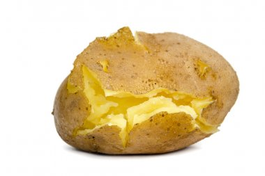 Unpeeled cracked cooked potato on a white background