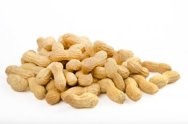Many peanuts in shells on a white background