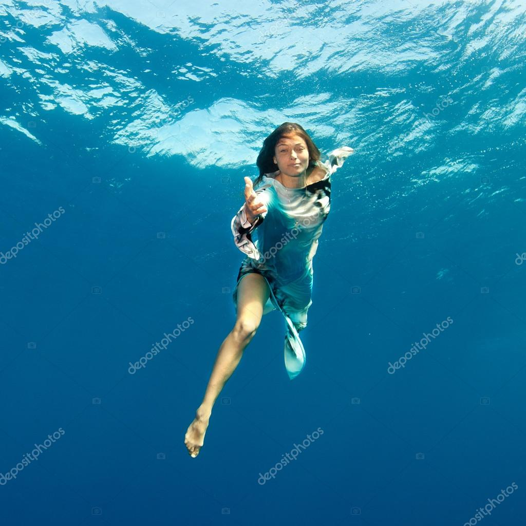girl giving hand to you underwater