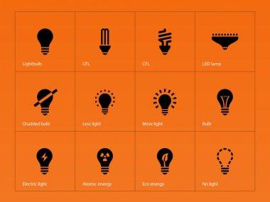 Light bulb lamp icons on orange background.