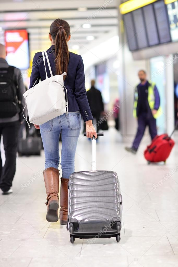 woman leaving with luggage - 600×900