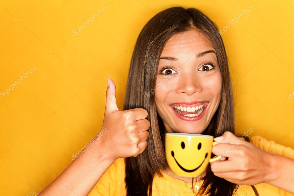 depositphotos_21564169-stock-photo-woman-drinking-coffee-happy-thumbs.jpg