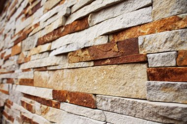 Brown-yellow stacked stone wall