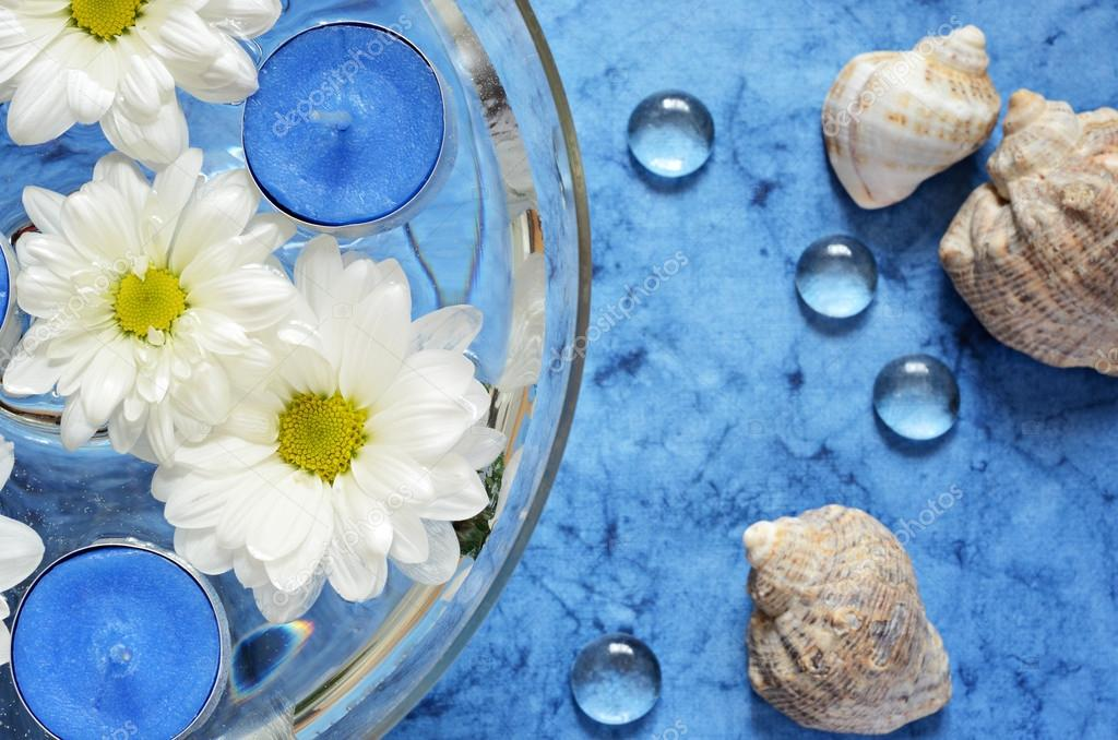 Daisies and blue candles