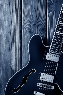electric guitar on blue