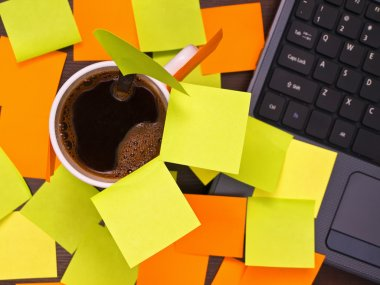 Coffee cup and blankpost it notes