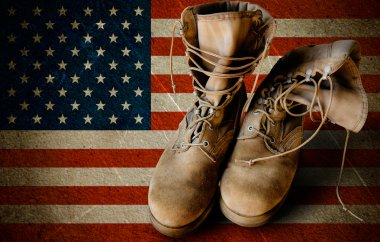 Grunge US Army boots on sandy american flag background collage stock vector