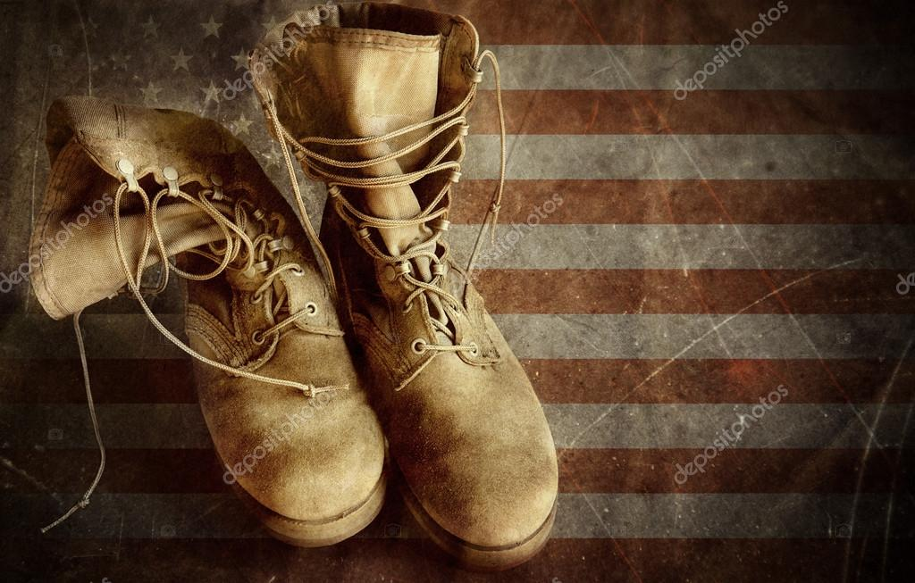US Army boots on the old paper flag. 4th of july background