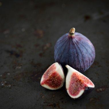 Figs on rustic table in dark tones