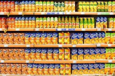 Natural Juice Bottles On Supermarket Stand
