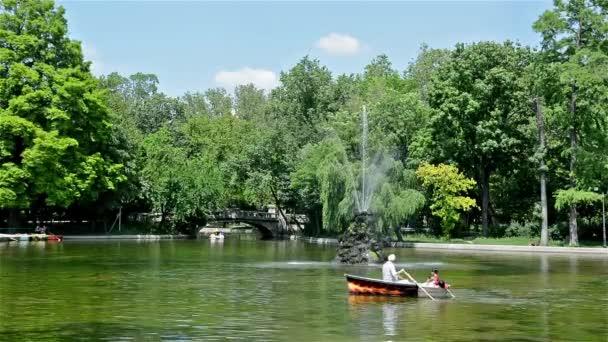People Boat Rowing In The Cismigiu Gardens