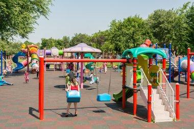 Happy Children Having Fun On Playground