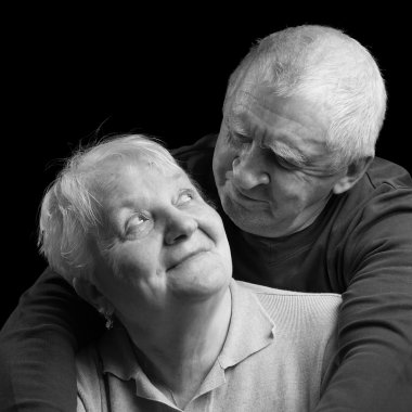 happy older couple on a black background