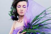 Fotografie krásy dívka s květy orchidejí a profesionální make-up