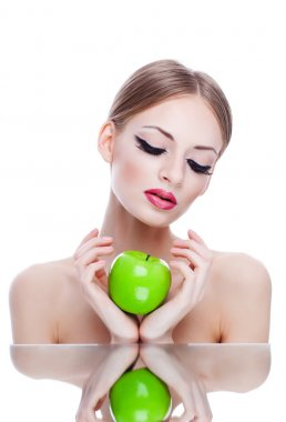 young beauty woman with green apple on white background