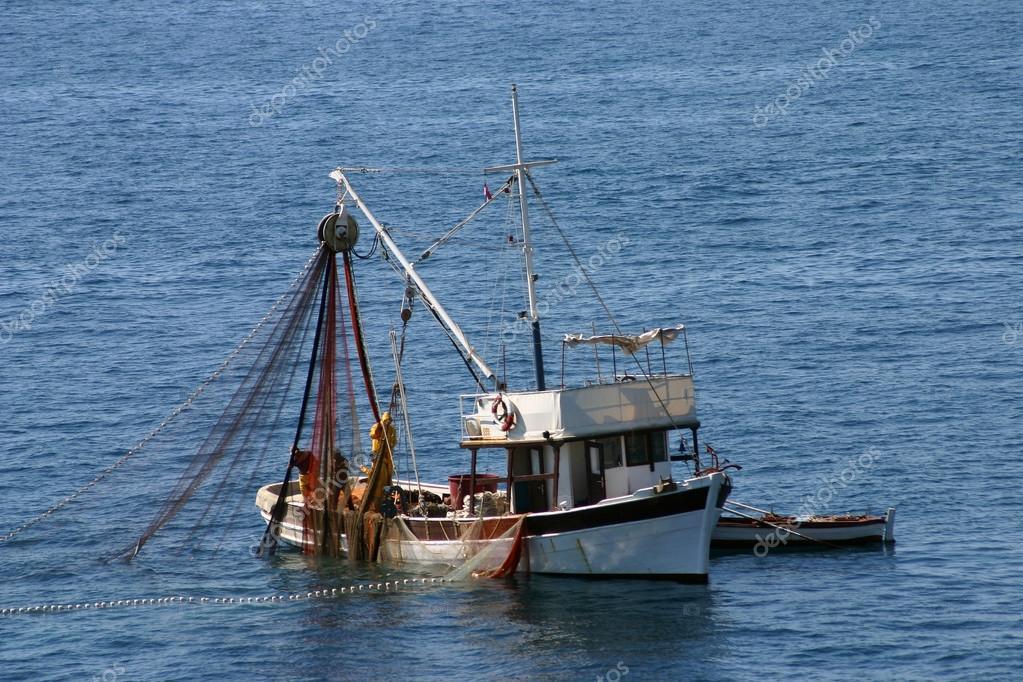 Fishing boats at work