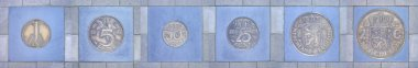 Colleciont of former Dutch coins in a row