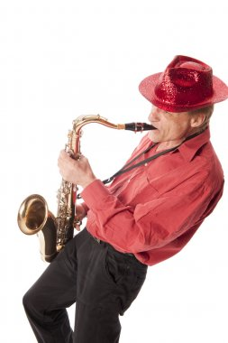 Man playing saxophone leaning backwards
