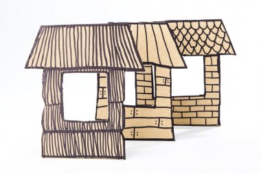 Straw, sticks and briks houses made with cardboard.