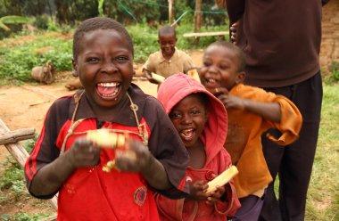 Happy Ugandan Children Eating Sugarcane