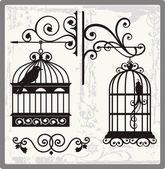 Fotografia gabbie per uccelli depoca con decorazioni ornamentali