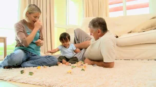 baby living room parents with baby on the living room carpet 10607