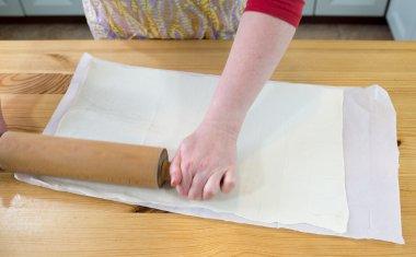 Preparing puff pastry.