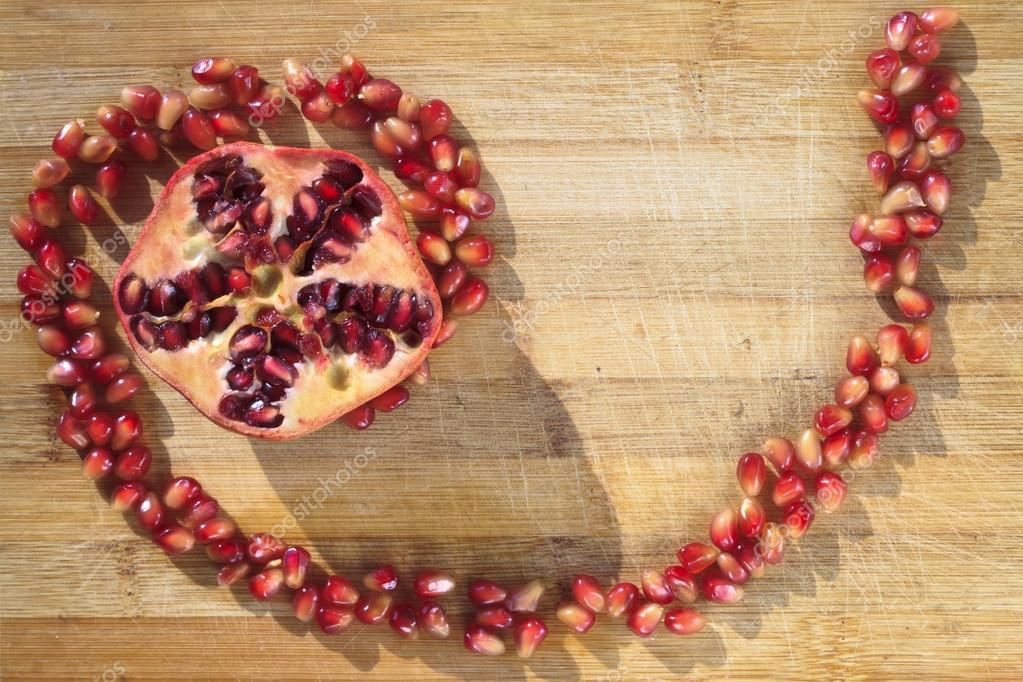 Pomegranate on wood
