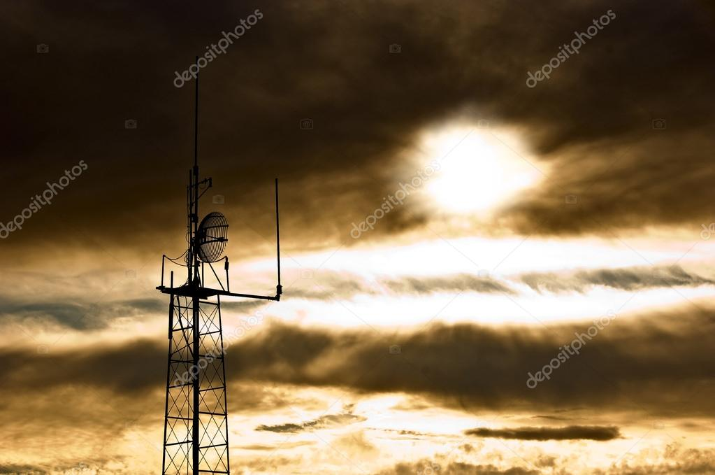 Apocalyptic sky with dramatic clouds and radio antenna. A scene reminiscent of the day of judgment.