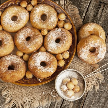 Tasty sweet donuts with icing sugar