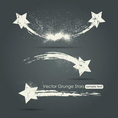 Grunge set of shooting stars