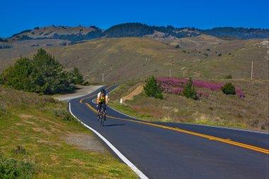 Bicyclist riding California Highway one near Stinson Beach.