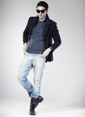 handsome man dressed casual posing in the studio