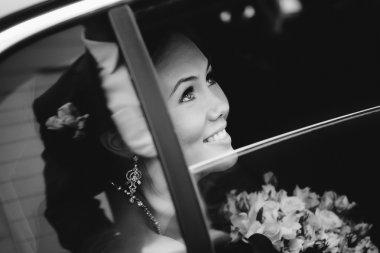 Happy bride in window a wedding limo