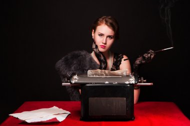 The beautiful girl at a typewriter