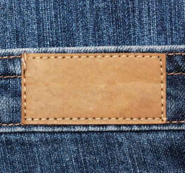 Blank paper label tag on blue jeans
