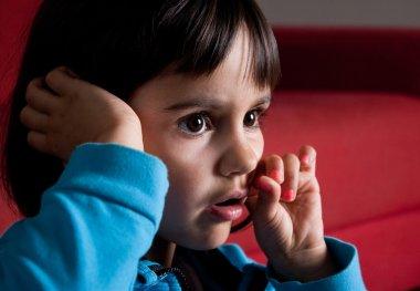 little girl watching tv alone