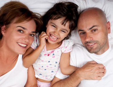 Happy family in bed on a sunday morning