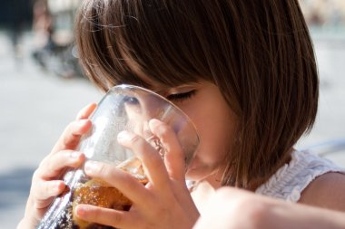 4 years old girl drinking cola